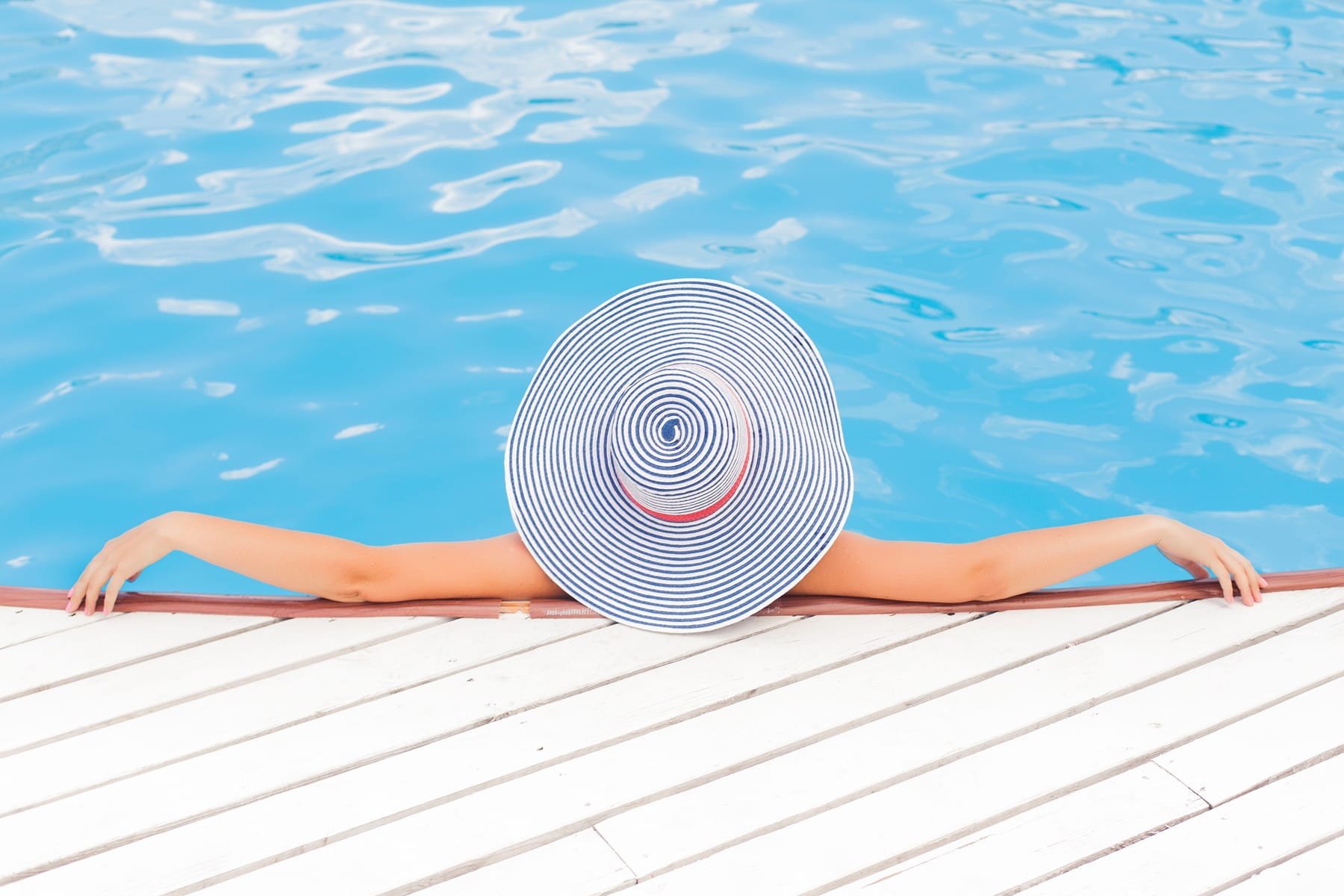 Lady relaxing in pool at Malta Hotel